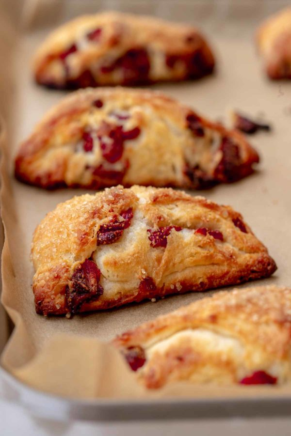 Easy scone recipe baking on a parchment sheet