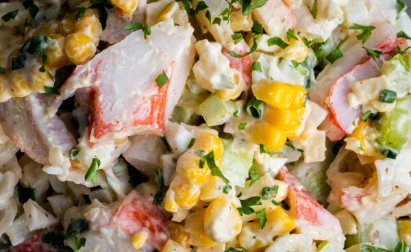 Close up of a crab salad recipe made with corn.