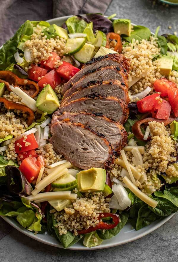 Quinoa salad with herb dressing on a large platter