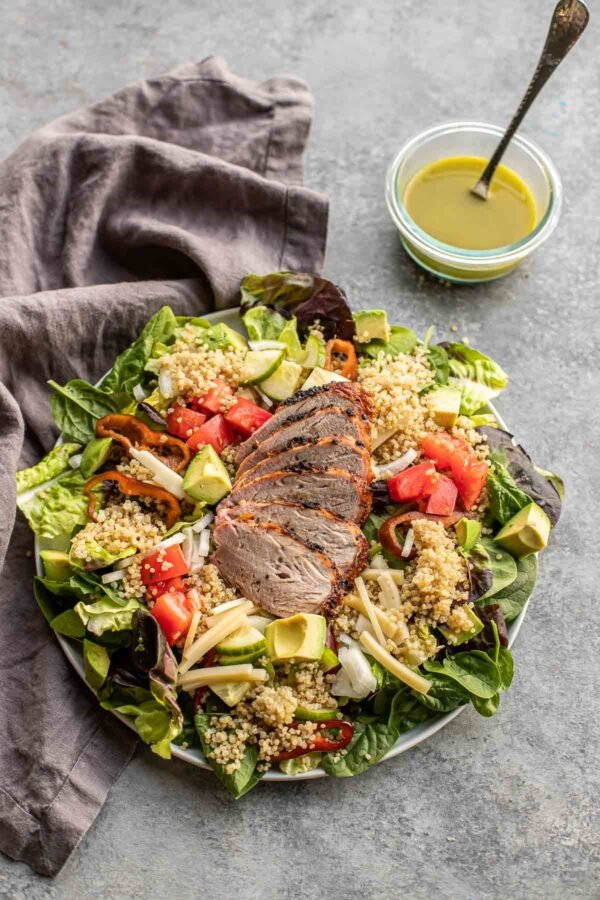 Quinoa salad with herb dressing on a countertop