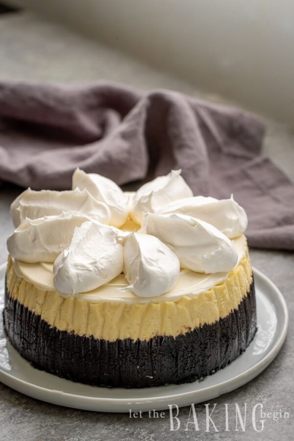 New York style cheesecake topped with fresh cream