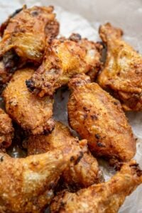 These crispy baked chicken wings taste just like the fried version. You will NEVER guess what the secret to getting crispy skin is!