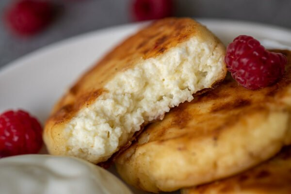 Russian pancakes with a bite taken out showing the texture