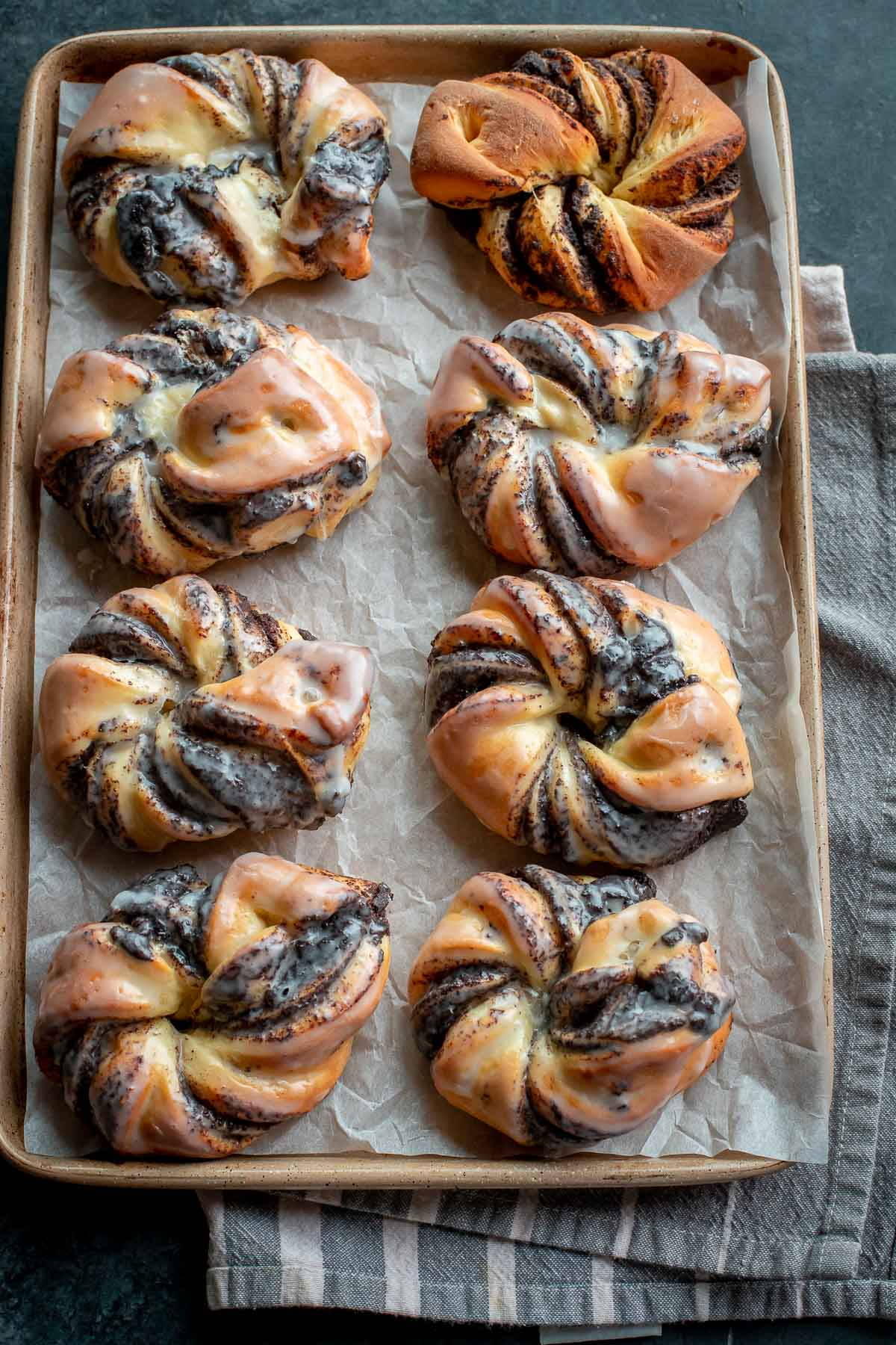 Sweet Buns with Poppy Seeds set on a baking sheet, top view.