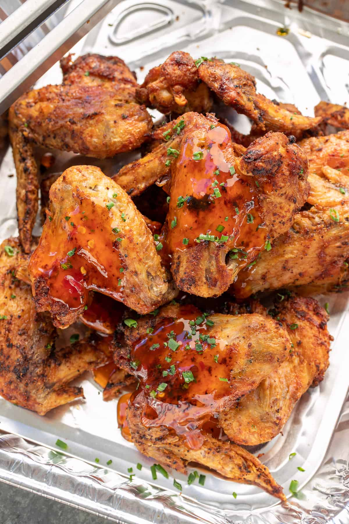 Air Fryer Chicken wings coated with sauce, overhead view.